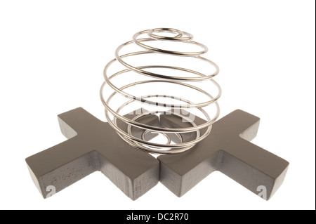 Iron wire tangled up into a spiral ball resulting in a shiny chrome sphere and standing on top of two gray crosses - Stock Photo