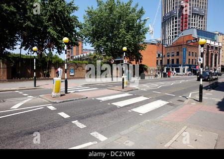 belisha beacon pedestrian crossing across road in central London England UK - Stock Photo