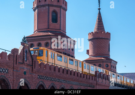 U-Bahn (subway) train traversing the Oberbaum Bruecke, Oberbaum Bridge, Berlin Germany. - Stock Photo