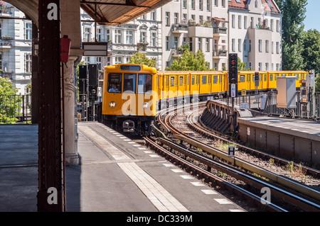 Berlin Germany - Commuter train approaching railway station - Stock Photo