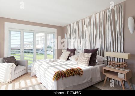 Sunlight in modern bedroom - Stock Photo