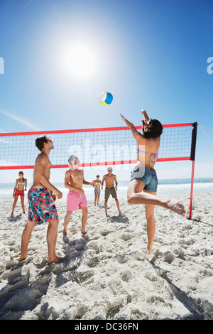 Friends playing beach volleyball - Stock Photo