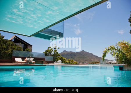 Luxury swimming pool with mountain view - Stock Photo