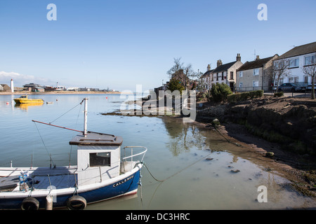 Fishing boats on Esk Estuary at Ferryden in Scotland - Stock Photo