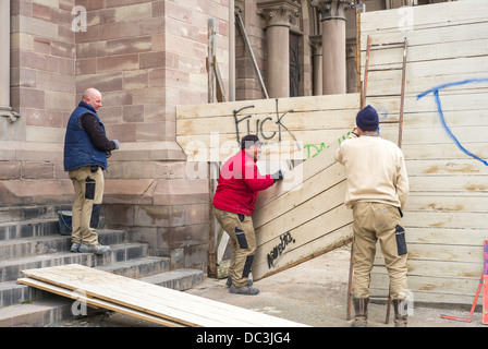 Carpenters building a wooden fence Strasbourg Alsace France - Stock Photo