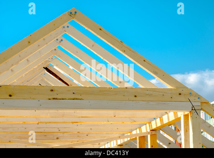 Rafters of the roof frame of a house under construction