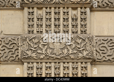 Imperial eagle and thunderbolts on a wall of the Louvre Palace in Paris. - Stock Photo