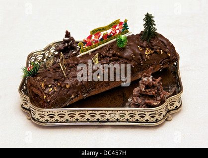 'Bûche de Noël' (yule log), this one is chocolate filled with raspberry jam. French traditional dessert for Christmas. - Stock Photo