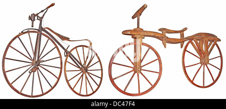 Old wooden bicycle isolated on white background - Stock Photo