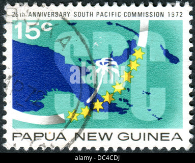 A postage stamp printed in Papua New Guinea, is dedicated to 25th Anniversary South Pacific Commission - Stock Photo
