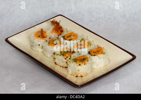 Authentic Japanese food photographed with a contemporary American flair.Surf and turf roll with shrimp and grilled - Stock Photo
