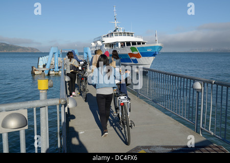 Passengers with bikes boarding ferry to SF, Sausalito, CA - Stock Photo