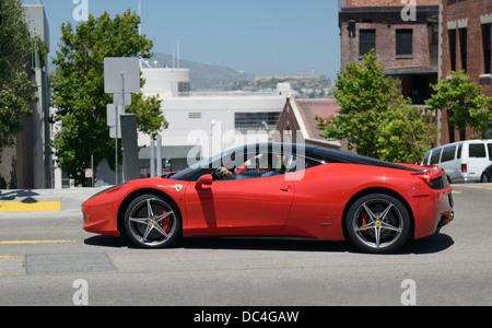 Ferrari on a street in San Francisco, CA - Stock Photo