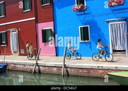 Kids by bike on Burano Island, Isola di Burano Island - Stock Photo
