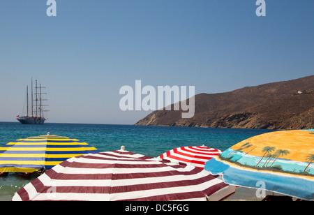 Colourful Umbrellas on a Greek beach - Stock Photo