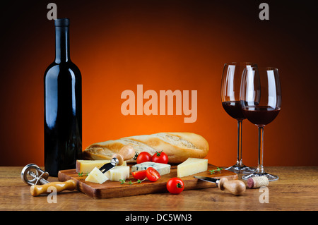 still life with romantic dinner, various gourmet cheese and red wine - Stock Photo