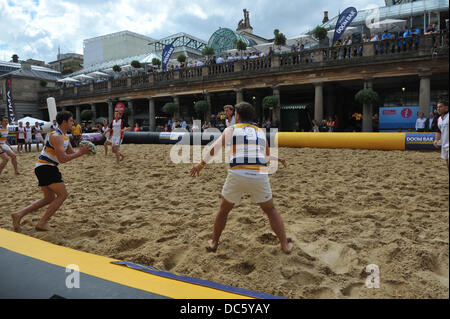 Covent Garden, London, UK. 9th August 2013. Players compete in the Doom Bar London Beach Rugby tournament in London's - Stock Photo