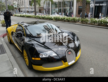 Bugatti Veyron with toursit taking picture, Rodeo Drive, Beverly Hills, CA - Stock Photo