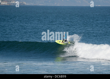 Lone surfer riding a wave, Surfrider Beach, Malibu, CA - Stock Photo