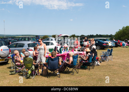 Ladies picnicking in the car park before racing at Goodwood - Stock Photo