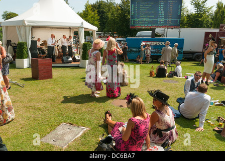 Racegoers enjoying the entertainment at Glorious Goodwood - Stock Photo