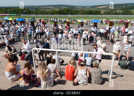 Ladies sitting on the steps of the Gordon enclosure stand - Stock Photo