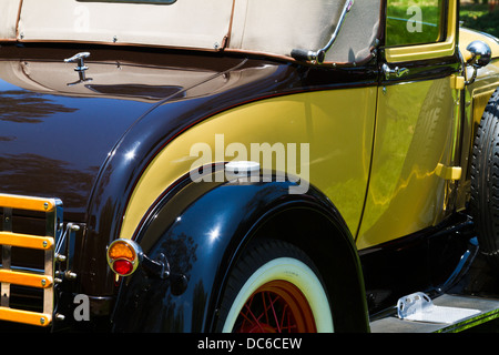 Detailed view of a beautifully restored Model A Ford roadster. - Stock Photo