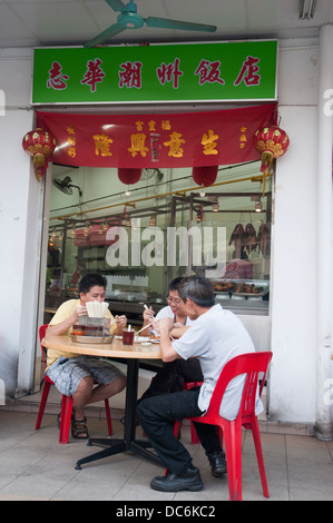 Diners at a Kopitiam (coffee shop) on Geylang Road in Singapore - Stock Photo