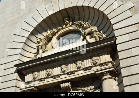 Ornate stonework on exterior of St. Mary le Bow church in Cheapside, City of London, London, UK. - Stock Photo