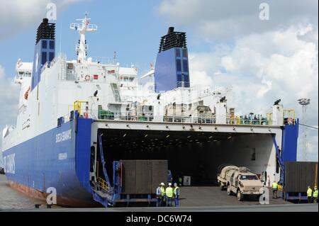 Armored military vehicles of the Bundeswehr are unloaded from the deck of cargo ship 'Suecia Seaways' in Emden, - Stock Photo