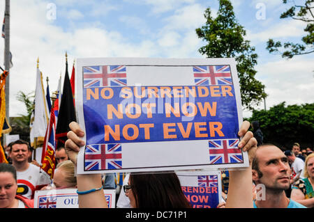 Belfast, Northern Ireland. 10th August 2013 - Orange Order supporter holds up a poster saying 'No Surrender. Not - Stock Photo