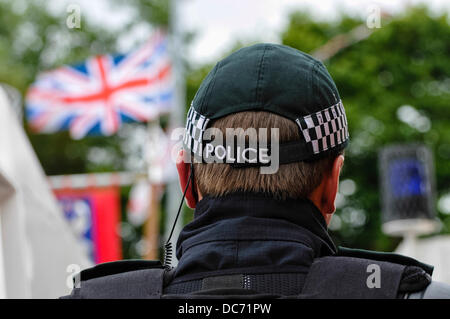 Belfast, Northern Ireland. 10th August 2013 - PSNI officer wearing a soft baseball cap watches as loyalists protest - Stock Photo