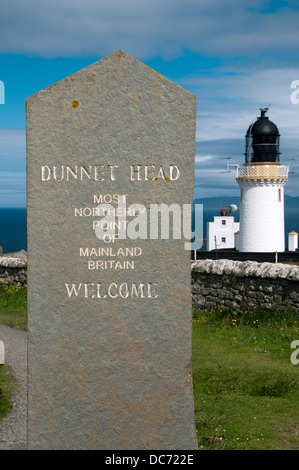 Stone welcome sign and lighthouse at Dunnet Head, most northerly point of the British mainland.  Caithness, Scotland, - Stock Photo
