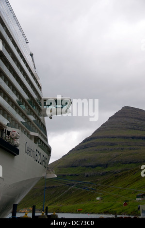 The Celebrity cruise ship, the Eclipse, sits at the dock in Denmark's Faroe Islands. - Stock Photo