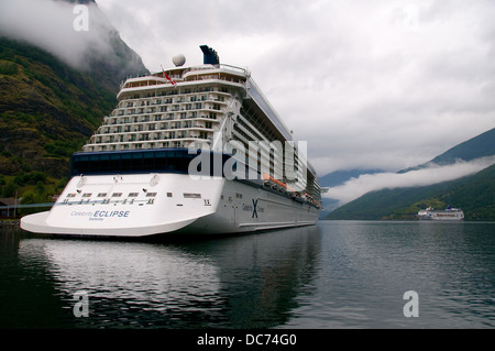 The Celebrity Eclipse cruise ship sits at the dock terminal in the tiny fjord settlement of Flam Norway. - Stock Photo