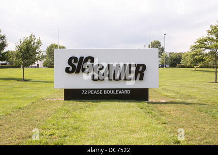 A sign outside of a Sig Sauer firearms manufacturing facility.  - Stock Photo