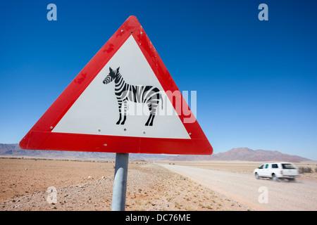 Zebra crossing animal warning sign, Namib Desert, Namibia, April 2013 - Stock Photo