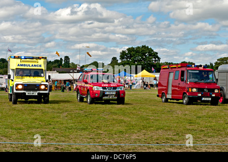 Emergency vehicles displayed at a transport fair in Lingfield, Sussex, UK - Stock Photo