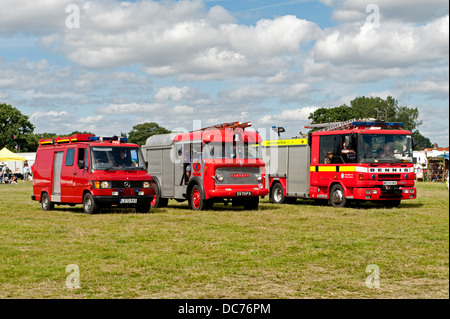 Fire engines past and present  displayed at a transport fair in Lingfield, Sussex, UK - Stock Photo