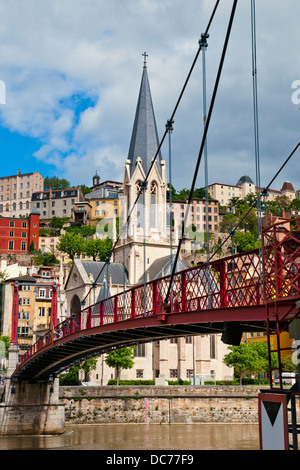 Spectacular views Suspension bridge on the Saone River and St.George church l´Eglise St. Georges, Lyon, France, - Stock Photo