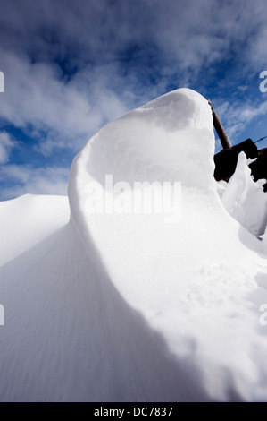 Patterns formed in snowdrifts at the back of drystone walls, Cumbria, UK - Stock Photo