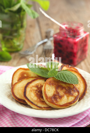 Pancakes with sour cream and black currant jam - Stock Photo