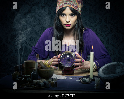 Fortune teller / mystic  with crystal ball and tarrot cards - Stock Photo