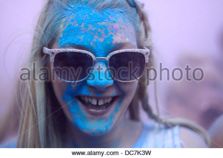 Girl covered in blue holi colour powder - Stock Photo