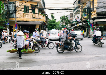 Hanoi, Vietnam, busy traffic road scene with smoky ...