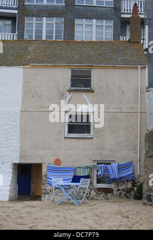 An old fisherman's cottage built right on the beach in the harbor in St.Ives Cornwall England - Stock Photo