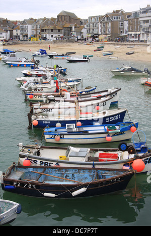 A string of small fishing boats in St.Ives harbor in Cornwall England. - Stock Photo