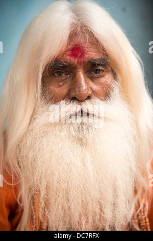 Sadhu, Holy Man sitting by Dashashwamegh Ghat, Varanasi, Uttar Pradesh, India - Stock Photo