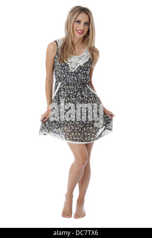 Model Released. Happy Young Woman Wearing a Mini Dress - Stock Photo