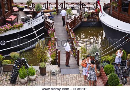 Vltava riverbank boat restaurants, Prague Czech Republic Europe - Stock Photo